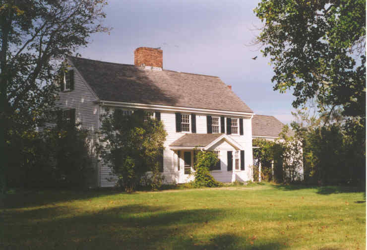 A white house with a central chimney