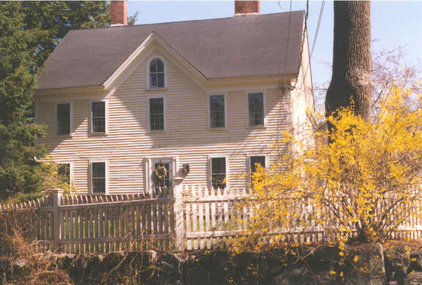 A colonial style house with clapboards