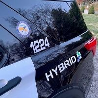 side of car that says hybrid